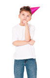 Little boy in birthday cap. Funny boy in birthday cap, isolated on white background Stock Image