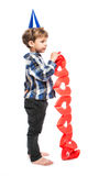 Little boy in birthday hat with paper garland of red hearts. Cute little boy in birthday hat holding paper garland of red hearts on white background Stock Image