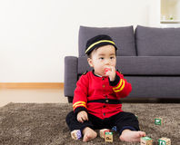 Little boy bite toy block Royalty Free Stock Image