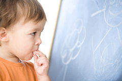 Little boy is biting chalk Royalty Free Stock Photography
