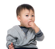 Little boy biting his finger Royalty Free Stock Images