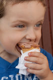 Boy eating an icecream Royalty Free Stock Photos