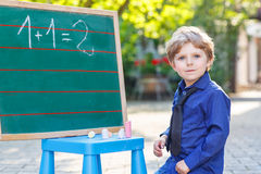 Little boy at blackboard learning to write Royalty Free Stock Photography