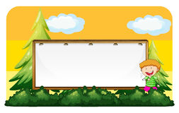Little boy and blank board Royalty Free Stock Images