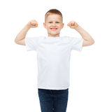 Little boy in blank white t-shirt showing muscles Stock Photos