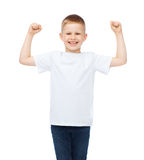 Little boy in blank white t-shirt showing muscles Royalty Free Stock Photo
