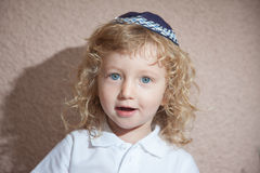 The little boy with blond curls in Jewish skullcap Royalty Free Stock Photos