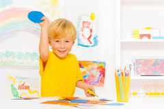 Little boy with blond hair and cardboard circle Royalty Free Stock Image