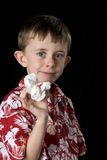 Little boy with a bloody nose. Little boy proudly displays his tissue after a bloody nose. vertical framing with a black background Royalty Free Stock Photos