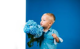 Little boy at blooming flower. Childrens day. Small baby boy. New life concept. Spring holiday. Summer. Mothers or. Womens day. Spring flowers. Childhood royalty free stock photo