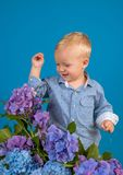 Little boy at blooming flower. Childrens day. Small baby boy. New life concept. Spring holiday. Summer. Mothers or. Womens day. Spring flowers. Childhood royalty free stock photos