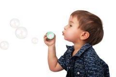 Little boy blow bubbles. Little happy boy blow bubbles on white royalty free stock photography