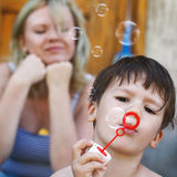 Little boy blow soap bubbles Royalty Free Stock Photos