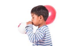 Little boy blow up balloon stock photos