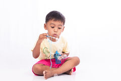 Little boy blowing bubble Stock Photos