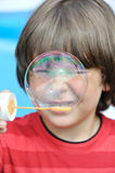Little boy blowing bubbles Royalty Free Stock Photo