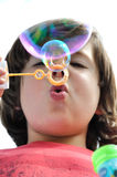Little boy blowing bubbles Royalty Free Stock Photos
