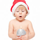 Little boy blowing on the candle Stock Photos