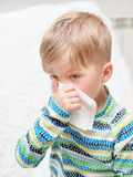 Little boy blowing his nose Stock Photo