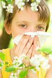Little boy is blowing his nose. Outdoors Royalty Free Stock Photography