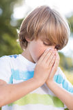Little boy blowing his nose Royalty Free Stock Photos