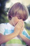 Little boy blowing his nose Stock Photos