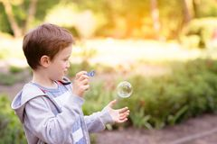 Little boy blowing soap bubbles Royalty Free Stock Image