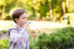 Little boy blowing soap bubbles Royalty Free Stock Photography