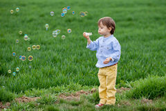 Little boy blowing soap bubbles Stock Photography