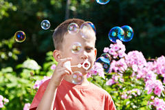 Little boy blowing soap bubbles Royalty Free Stock Images