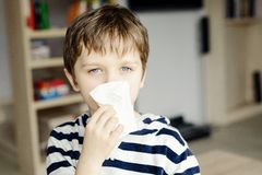 Little boy blows his nose Stock Photography