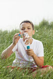 Little boy blows soap bubbles Stock Photo