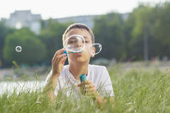 Little boy blows soap bubbles Royalty Free Stock Photos