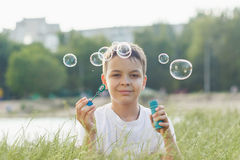 Little boy blows soap bubbles Royalty Free Stock Images