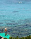 Little Boy Blue. Looks on longingly into the clear waters of the Med as his Family enjoy deeper waters Stock Images