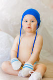 A little boy in a blue cap and mittens Royalty Free Stock Photo
