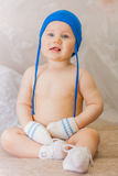 Little boy in a blue cap and mittens with blue eyes Royalty Free Stock Photos