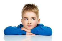 Little boy in blue cardigan. Dreaming little boy in blue cardigan and yellow shirt Stock Photography