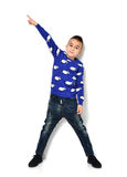 Little boy in blue cloth jeans standing and pointing finger at t. Fashion beautiful little boy in blue cloth jeans standing and pointing finger at the corner Stock Photography