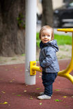Little boy with blue eyes on a winter walk. Small boy playing outside. Portrait of 2 year old toddler with blond hair and blue eyes Royalty Free Stock Photos