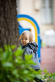 Little boy with blue eyes on a winter walk. Small boy playing outside. Portrait of 2 year old toddler with blond hair and blue eyes Stock Photos