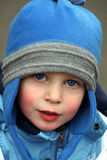 Little boy in blue hat Stock Photos