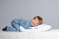 Little boy in blue pyjamas Royalty Free Stock Photography