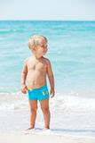 Little boy and blue sea Stock Image