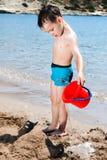 Little boy in blue sea Royalty Free Stock Photo
