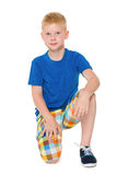 Little boy in a blue shirt sits Royalty Free Stock Images
