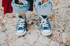 Little Boy in Blue Sneakers Stock Photography