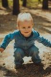 A little boy in a blue suit Stock Photos
