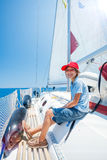 Little boy on board of sailing yacht on summer cruise. Travel adventure, yachting with child on family vacation. Stock Images