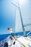 Little boy on board of sailing yacht on summer cruise. Travel adventure, yachting with child on family vacation. Royalty Free Stock Photography